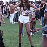 Jourdan Dunn wearing a crop top and denim shorts at the festival.