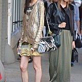 A metallic knit and patent brogues took the focus in this mix; on the left, it's all about an easy military-hued maxi. Source: Greg Kessler