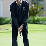Holding a Golf Club.