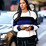 A color-block sweater is the perfect way to enhance a top-stitch miniskirt.