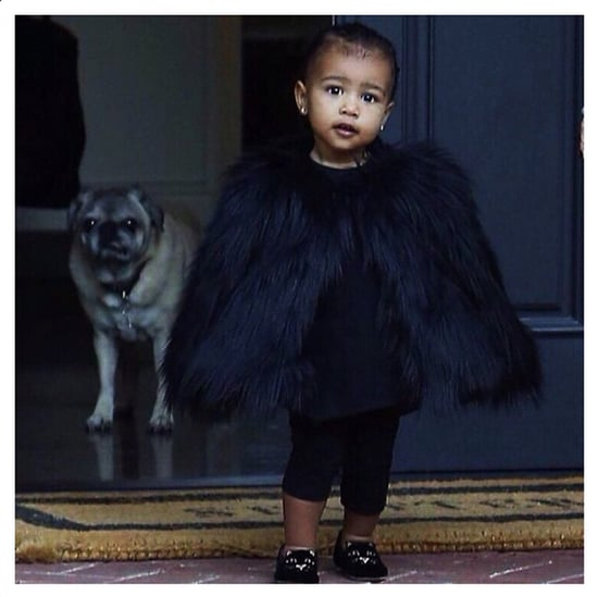 North West Wearing Fur Coat and Charlotte Olympia Cat Flats
