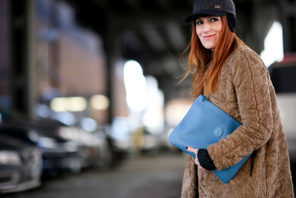 Armed and ready with her oversize clutch.
