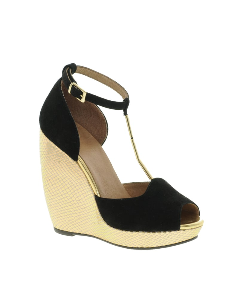 These are the perfect wedges for a night out. The metallic platform and thin, gold t-strap read dressy, while the black suede vamp looks sleek. Asos Hacienda Leather Wedges ($99)