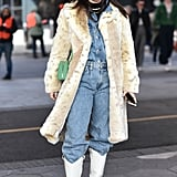 Winter Outfit Idea: A Furry Jacket and Cowboy Boots Over Denim