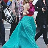 Jennifer Lopez wore a purple and teal dress with purple heels as she walked to the American Idol stage.