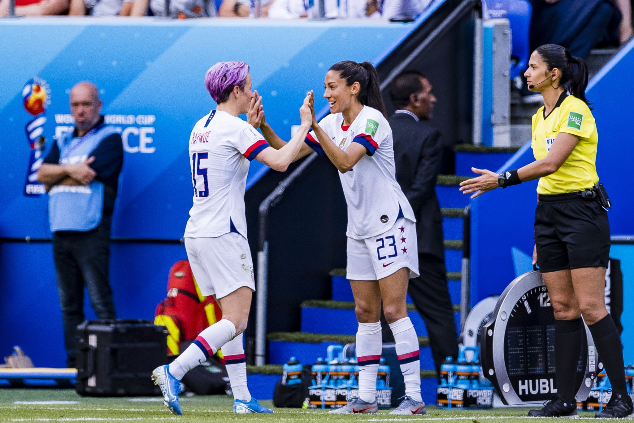 LYON, FRANCE - JULY 07: Megan Rapinoe of United States (L) leaves the field for substitution with Christen Press of United States (R) during the 2019 FIFA Women's World Cup France Final match between The United State of America and The Netherlands at Stade de Lyon on July 7, 2019 in Lyon, France. (Photo by Marcio Machado/Getty Images)
