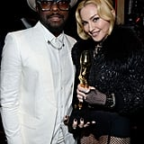 Madonna held up her award with Will.i.am.