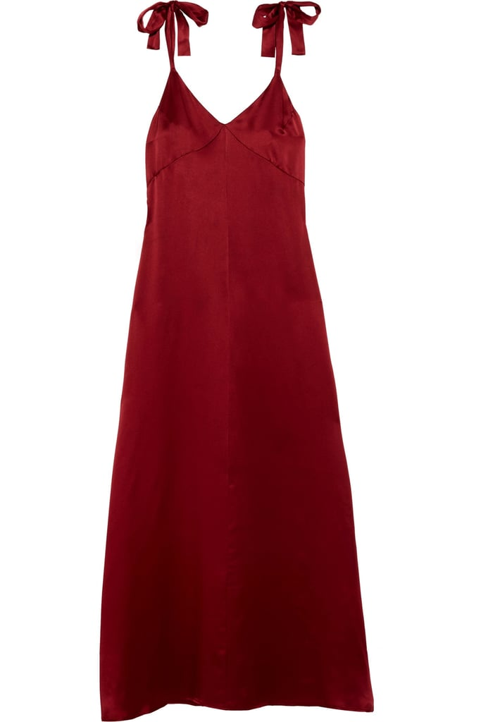 """""""I love the rich, holiday hue and subtly sweet bows on this Reformation x Net-a-Porter slip dress ($300). It feels totally contemporary and completely classic all at once — making it perfect for any holiday party on the roster."""" — HWM"""