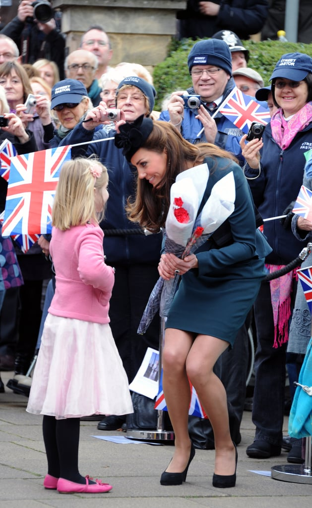 Before she embarked on the Diamond Jubilee tour in March 2012, Kate chatted with well-wishers — including this cute little girl — outside Leicester Cathedral in England.