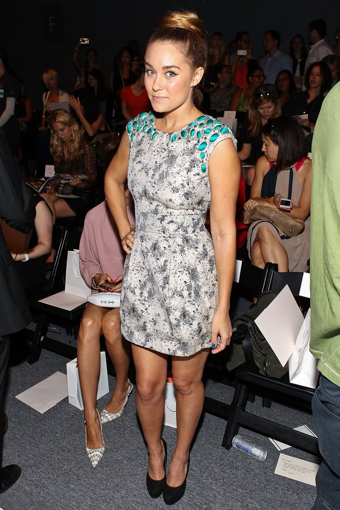 LC posed in a printed Lela Rose mini while sitting front row at the designer's show during New York Fashion Week in 2009. Lesson from Lauren: accentuate your dress's embellishments with co-ordinating nail polish.
