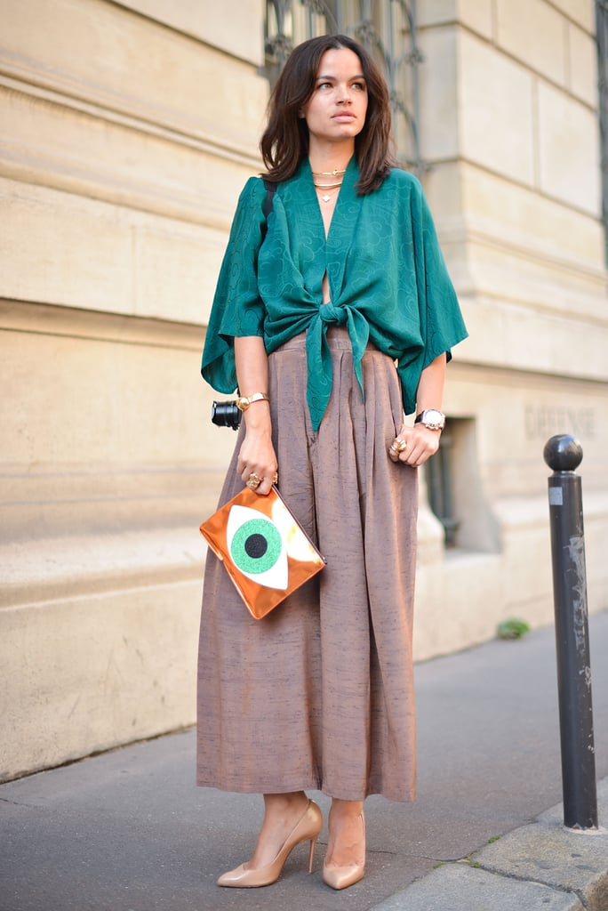 A loosely tied top over culottes