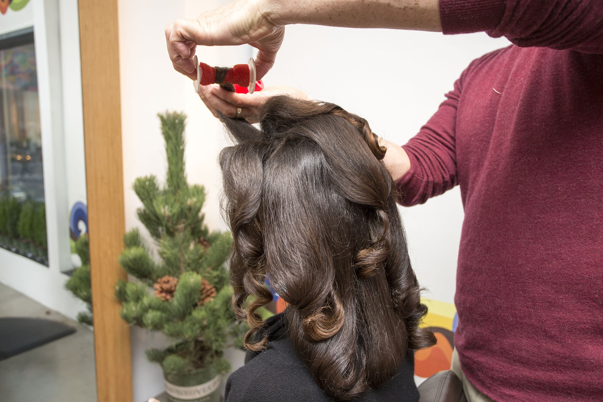 After hair has cooled completely, remove the rollers to release large curls. Make sure to twirl the hair around with your finger to form loose ringlets.