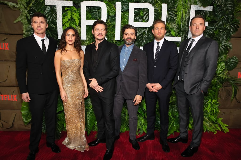 It was a true joy to see our internet boyfriends assembled together, showing off their best smolder for the premiere of Triple Frontier on March 3 in NYC. Ben Affleck, Charlie Hunnam, Oscar Isaac, Garret Hedlund, and Pedro Pascal reunited on the red carpet to promote their action flick, which hits Netflix on March 13. They couldn't help joking around and whispering as they posed for photos — maybe they were reminiscing on their shirtless shoots in Hawaii? Those days are certainly tough for us to forget.  See some of the best snaps from the night below, and catch up on the Triple Frontier trailers before the movie drops next week.
