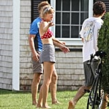 Taylor Swift visited boyfriend Conor Kennedy and wore a red polka-dot bikini.