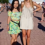 A parrot print made this two-piece matching crop top set stand out, but not so much that her friend's fringed Zara dress went unnoticed.
