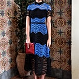 Mandy Moore punctuated her black and blue Lela Rose dress with red accessories at Stuart Weitzman and W's party.