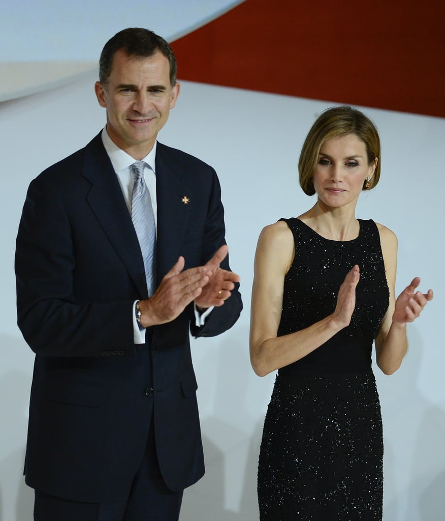 Spain's Queen Letizia and King Felipe VI attended the Prince of Girona Foundation's IMPULSA Awards on Thursday in Girona, Spain, where Letizia sported a faux-bob hairstyle. The event marked King Felipe VI's first official trip since his recent coronation, and in recent weeks, he and his wife have been in the international spotlight as the world gets to know more about Queen Letizia and the new king. For this week's event, the queen donned a sparkly black dress with her shorter 'do, standing alongside her husband as the awards were presented to young entrepreneurs. Take a look at the best photos from the event below!
