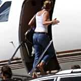 Jennifer Aniston boards a private plane.