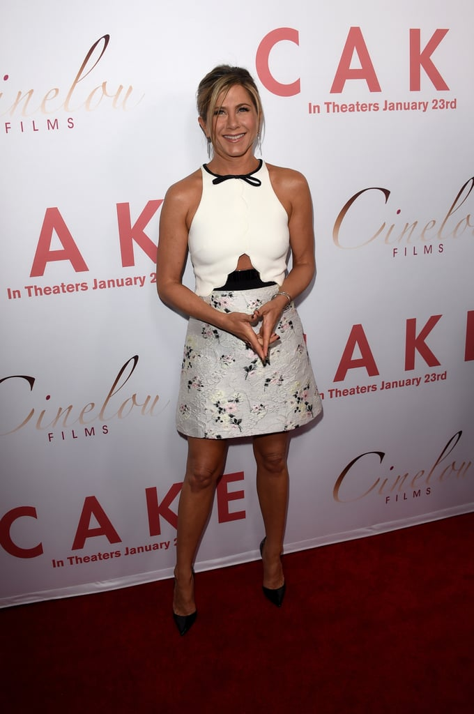 "Jennifer Aniston was all smiles at the LA premiere of Cake on Wednesday, stepping out in a white and floral dress with cutout details. The actress posed for pictures on the red carpet both solo and alongside actor Chris Messina, hugging him and laughing. It's been a busy week for Jennifer, as she and Justin Theroux stepped out for the Golden Globes on Sunday. Before the show, Jennifer showed off her playful side and grabbed Kate Hudson's butt, joking that it was ""irresistible."" Afterward, she linked up with Selena Gomez at InStyle's star-studded Globes bash, where Justin also mingled with Paul Rudd. Meanwhile, the Critics' Choice Awards are on Thursday, and Jennifer is among this year's Critics' Choice nominees. Keep reading for all the best pictures of Jennifer and other stars at the LA premiere of Cake."