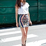 Statement print on a mini and seriously strappy footwear upgrade a white tee.