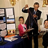 President Obama tried out a project created by Rebecca and Kimberly Yeung. The sisters are from Seattle, WA, and built a homemade spacecraft out of arrows and wood scraps before launching it into the stratosphere with a helium balloon.