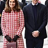 Wearing a Catherine Walker coat.