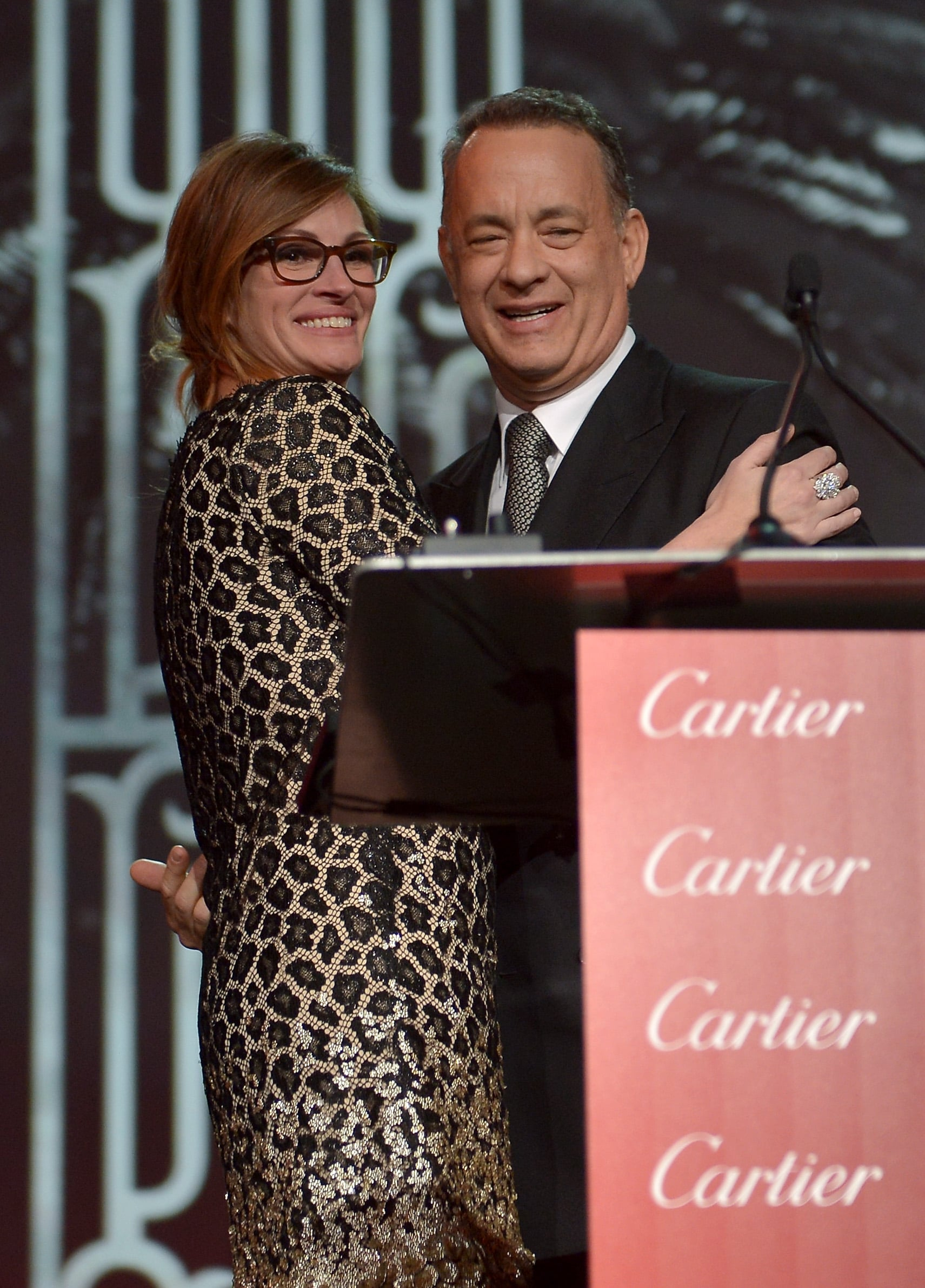 Tom Hanks's friend and former costar Julia Roberts presented him with his chairman's award.