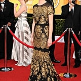 January Jones looked gorgeous in a black and gold Carolina Herrera gown.