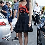 Caroline Issa outfitted a fit-and-flare skirt with a graphic tank and flat ankle-strap sandals for an easy daytime feel.