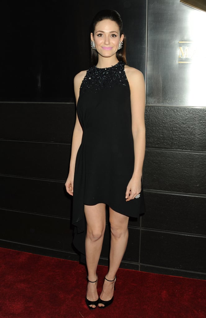 Emmy Rossum put her own spin on a halter-style LBD by Christian Dior — and we can't get over how gorgeous that black-crystal-embellished neckline is. To finish, the Shameless star accessorized with peep-toe heels and statement earrings.