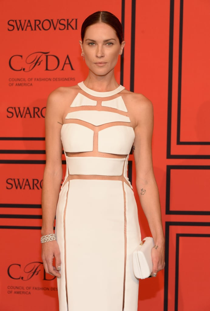 Erin Wasson's deep middle part complemented the architectural theme of her dress, while minimal makeup added to the simple elegance.
