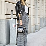 Houndstooth trousers feel totally classic, but a cropped moto jacket gives them a totally now finish.  Source: Le 21ème | Adam Katz Sinding