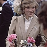 Just after getting married, Diana chose a neutral palette for her Caroline Charles coat and the plumes on her John Boyd hat for a trip to Wales.