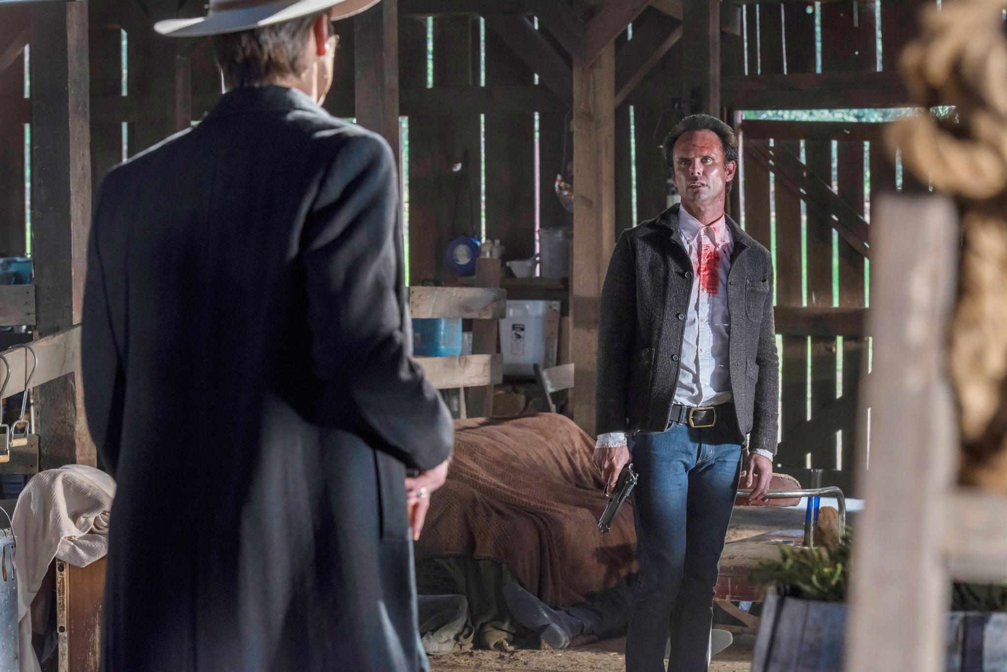 JUSTIFIED, (from left): Timothy Olyphant (back to camera), Walton Goggins, 'The Promise', (Season 6, ep. 613, aired April 14, 2015). photo: Prashant Gupta / FX / courtesy Everett Collection
