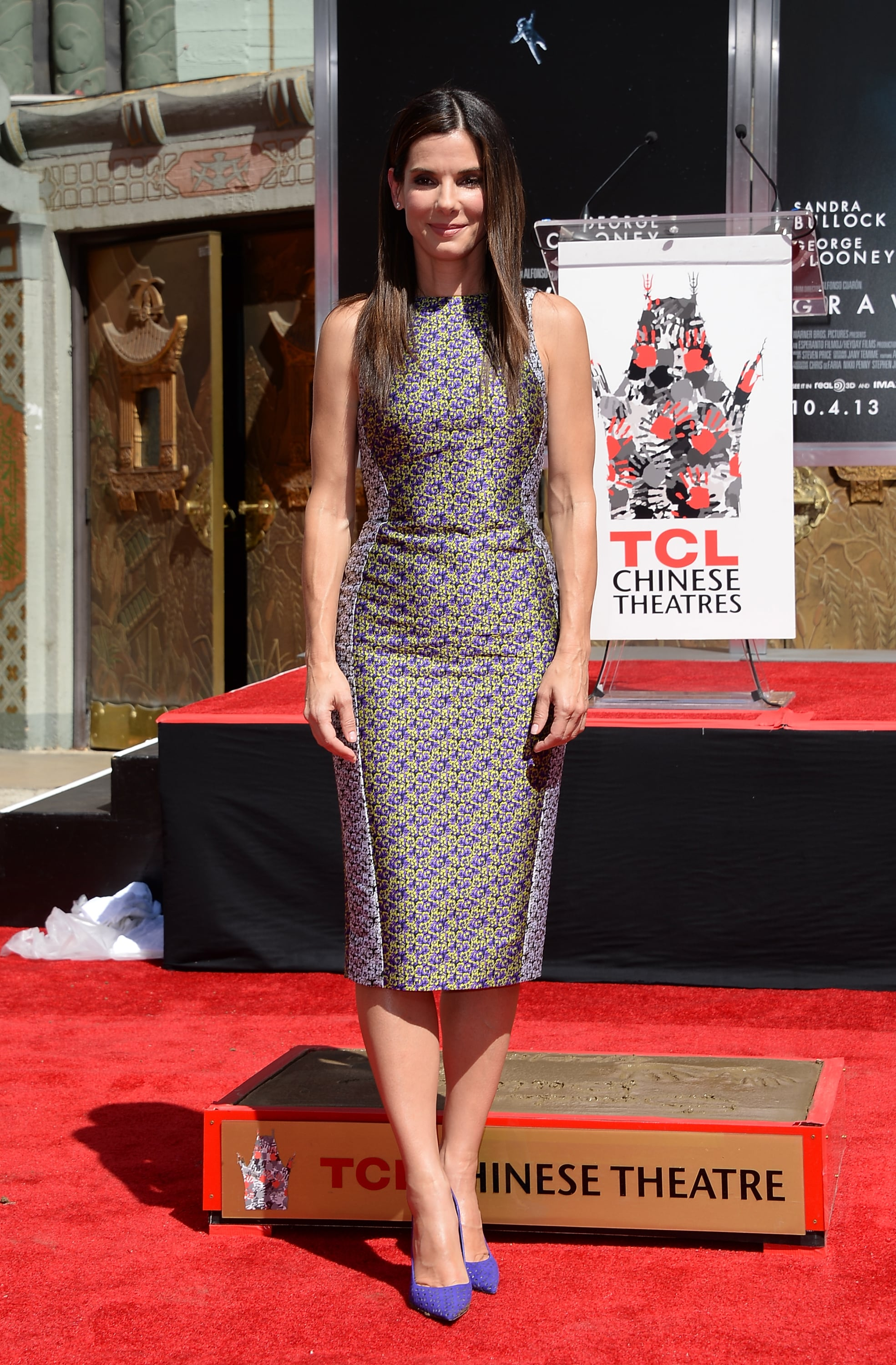 Sandra Bullock was a breath of fresh air in a floral sheath dress and matching purple pumps at her hand and footprint ceremont at the TCL Chinese Theatre in Hollywood.