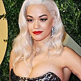 Rita Ora added some length to her hair with a platinum-blond wig, which she paired with bold brows and a bright red lipstick.