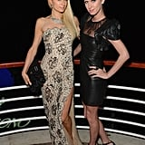 Paris Hilton showed off a thigh-high slit gown, while sister Nicky was right on trend in a pair of cap-toe pumps and a sheer-inset LBD at the de Grisogono party.