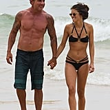 AnnaLynne McCord and her boyfriend, Dominic Purcell, showed PDA on the beach in his native Sydney, Australia, on Wednesday.