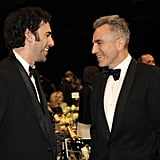 Sacha Baron Cohen and Daniel Day-Lewis shared a laugh during a break from the show.
