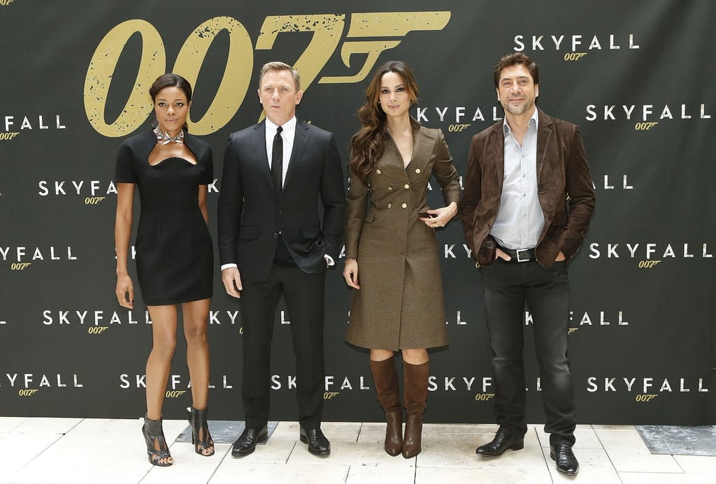 The cast of Skyfall kicked off promotions stateside with a photocall in NYC today. Daniel Craig and Javier Bardem posed with director Sam Mendes and the newest Bond girls, Naomie Harris and Bérénice Marlohe, at the Crosby Street Hotel. James Bond himself, Daniel, has already started promoting the project with his November Vanity Fair cover and recent role as host of Saturday Night Live. Javier, meanwhile, has been busy filming The Counselor in Spain with wife Penélope Cruz and costar Cameron Diaz. There will be plenty more red carpet moments for Daniel, Javier, Bérénice, and Naomie ahead of the film's Nov. 9 opening date. One thing we don't have to wait for is Adele's 007 theme song, which was released earlier this month.
