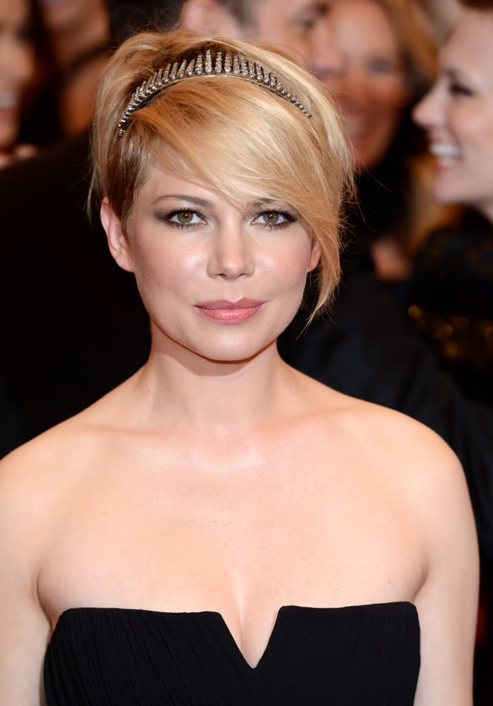 Michelle Williams attended the Met Gala earlier this year with a studded headband and smoky eye combination.