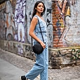 Laid-back, blazing days call for a denim tank, jeans, and Converse sneakers.