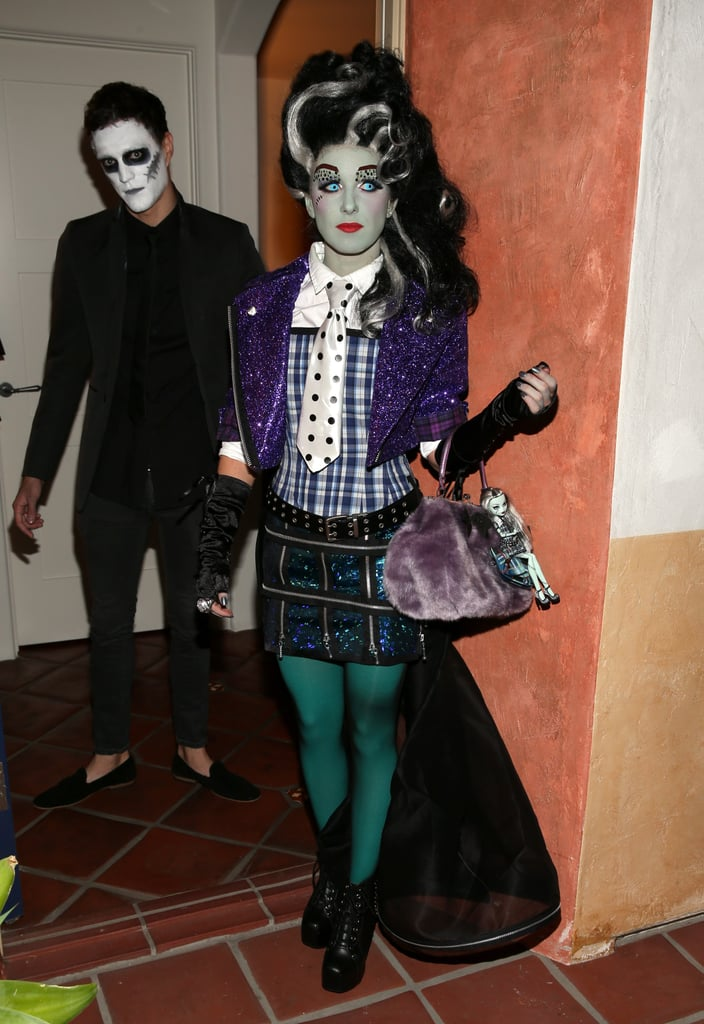 Shenae Grimes, in a cool mix of jewel-toned plaids and embellishments, dressed as Monster High's Frankie Stein for a Halloween party.