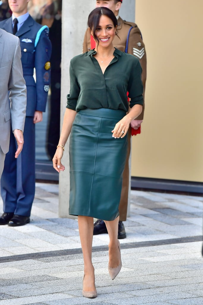 While her Suits character generally gravitates toward all-neutral looks, Meghan doesn't shy away from bright colors. Back in 2018, she rocked a leather pencil skirt and loose silk blouse in the same hunter green shade for a royal appearance.