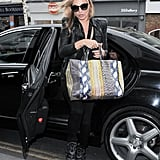 Kate left E & O restaurant in Notting Hill yesterday with her amazing bag.