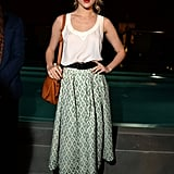 Suki Waterhouse tucked a silky white tank into a printed midi skirt at the DSquared2 cocktail party in Milan.