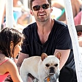 Hugh Jackman and his family adopted a Frenchie named Mochi and brought him along for a trip to St. Tropez in July 2011.