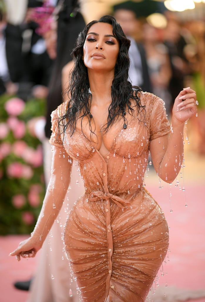 """Kim Kardashian wore one of her most memorable looks to date at the 2019 Met Gala. It didn't come without a price, however. In a behind-the-scenes video released by Vogue, which detailed Kim's fittings and preparty pampering, it's made clear just how formfitting her crystal-adorned Thierry Mugler dress was. In fact, it prevented her from sitting down or using the restroom throughout the entirety of the event.  """"Wish me luck."""" Inspired by 1957's Boy on a Dolphin, starring Sophia Loren, the dress was meant to make Kim look like she had emerged from the sea — specifically Malibu — and onto the red carpet. To create the effect of fabric clinging to her body, the design team used silicone and suited Kim up in an extremely tight corset by Mr Pearl underneath. Addressing Vogue's Anna Wintour in a to-camera moment, Kim said, """"Anna, if I don't sit down for dinner, now you know why. I'll be walking around mingling, talking, but I cannot hardly sit."""" She later added, """"Wish me luck. I won't be able to pee for about four hours."""" In a sentimental moment, Kim reflected on how it had always been a dream of hers to attend the Met Gala. """"I used to sit at home in bed on my computer looking at all of the pictures of everyone — dreaming one day that I could ever attend a Met ball and never really even believing that that would ever happen,"""" she said. """"I'm honestly so humbled by the idea that this is my life."""" Watch the fascinating video ahead.      Related:                                                                                                           This Year's Met Gala Was More Over-the-Top Than Ever —See Over 150 of the Best Photos"""