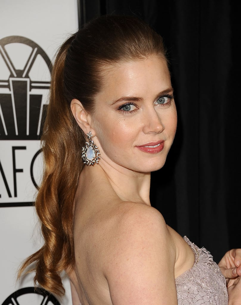 Ponytails are a great solution for women with long hair; just put your elastic near the crown like Amy Adams at the Film Critics Association Awards to best show off your lengths. Add some curls for an evening-ready look like Amy's.