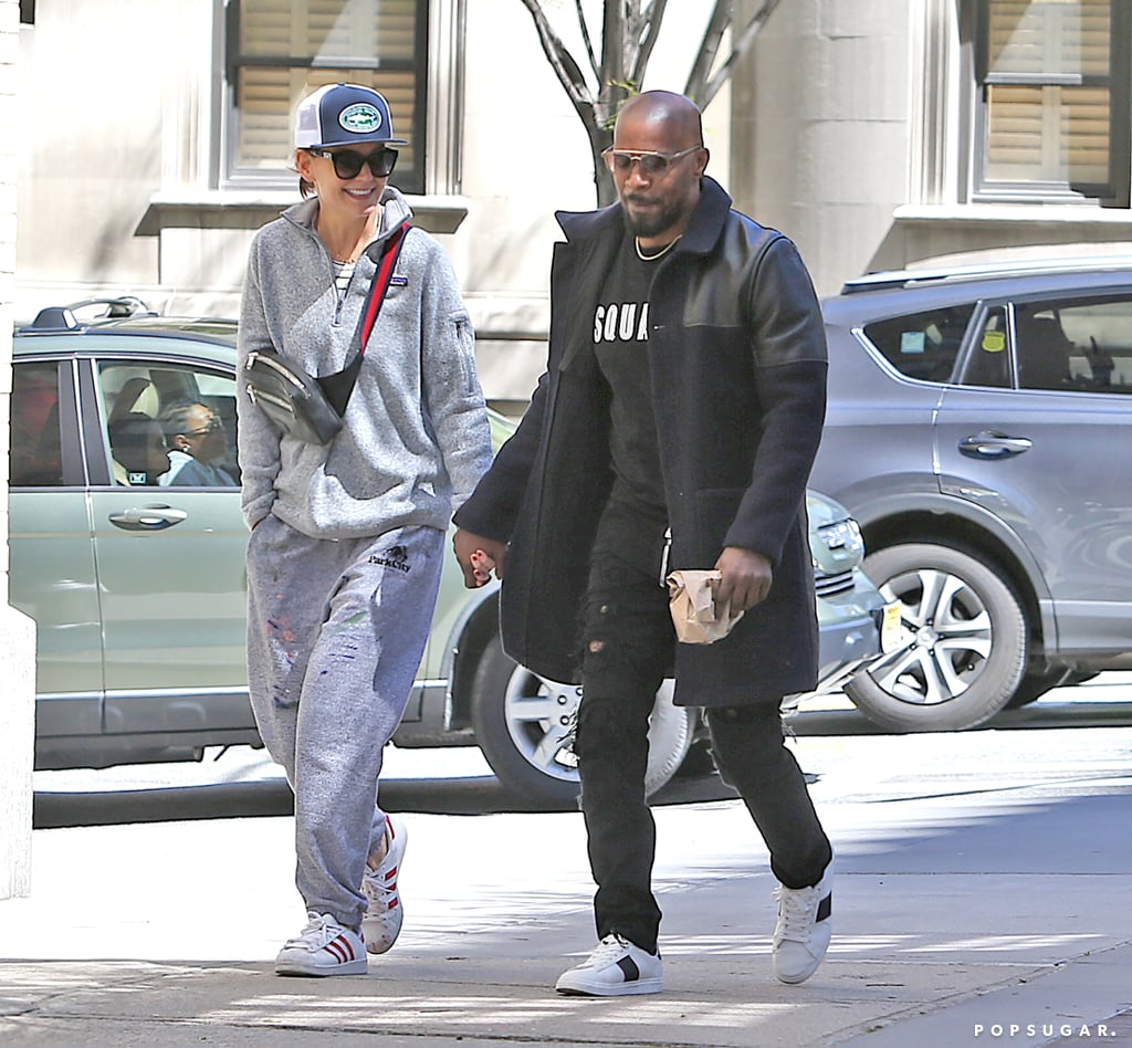Katie Holmes and Jamie Foxx are usually pretty private when it comes to their romance, but as of late, they seem to be getting more and more comfortable showing it off. On Tuesday, the couple were spotted on a sweet stroll around NYC. The 40-year-old actress kept things cool in a gray sweatsuit, while the 51-year-old actor looked stylish in a navy coat and distressed denim. Katie looked smitten as she flashed a few smiles and the duo held hands along the way.  Katie and Jamie have been together since 2013, however, their relationship was recently plagued by breakup rumors. Back in February, it was reported that the couple unexpectedly split, but they proved otherwise when they went for a casual stroll around Central Park in March. In fact, just last week, Jamie and Katie were seen on a fun family outing in LA with Jamie's 25-year-old daughter, Corinne. And judging by these latest pictures, Jamie and Katie certainly seem to be doing just fine!      Related:                                                                                                           Inside Katie Holmes's Incredibly Secretive Dating History